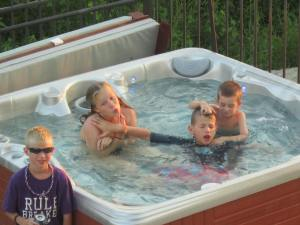 "The ""hot tubbers"" Olivia, Sam & Tommy with Luke"