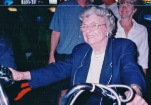Aunt Evie on a motorcycle in the game room at the old Buckeye Hall of Fame Cafe.