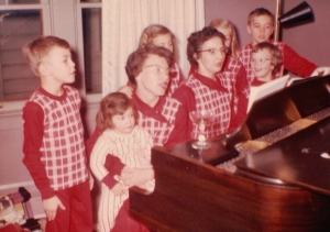 Johnny, Cecilia on Aunt Phyl's lap, Mom at piano, Kathy, MM, Jan & Jimmy