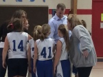 Sophia and teammates get last minute instructions from Chris and Meg